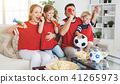 family of fans watching a football match on TV at home 41265973