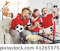 family of fans watching a football match on TV at home 41265975
