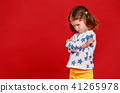 funny child girl in glasses on colored background 41265978