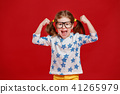 funny child girl in glasses on colored background 41265979