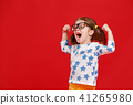 funny child girl in glasses on colored background 41265980