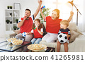 family of fans watching a football match on TV at home 41265981