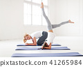 mother with child practicing yoga in headstand 41265984