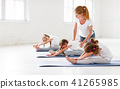 children practicing engaged in gymnastics and yoga with  teacher 41265985