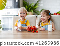 Happy children brother and sister eating strawberries with milk 41265986
