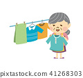 A woman hanging up the laundry 41268303