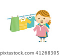 A woman hanging up the laundry 41268305