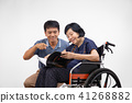 Elderly woman reading a book with son take care 41268882