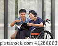 Elderly woman reading a book with son take care 41268883