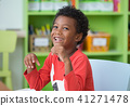 African American ethnicity kid smiling at library 41271478