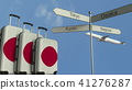 Travel baggage featuring flag of Japan, airplane and city sign post. Japanese tourism conceptual 3D 41276287