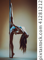 Young pole dancing woman 41281212
