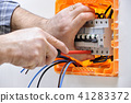 Electrician at work on an electrical panel 41283372