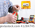 Electrician at work on an electrical system 41284745
