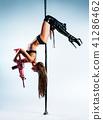 Woman poledancing 41286462