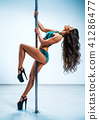Woman pole dancing 41286477