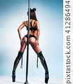 Woman poledancing 41286494