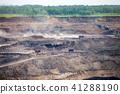 Dump trucks working at open coal mine 41288190