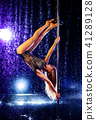 Woman pole dancing 41289128