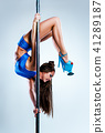 Woman poledancing on white 41289187