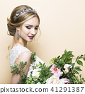 Young pretty bride with wedding bouquet 41291387