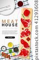 Raw beef steaks with seasoning on cutting board 41293608