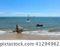 Surfer at beach - group of windsurfer on ocean 41294962