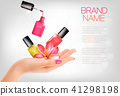 Manicured hands and several nail laquer bottles 41298198