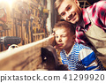 father and little son with wood plank at workshop 41299920