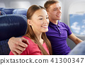 happy couple travelling by plane 41300347