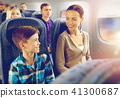happy mother and son traveling by plane 41300687