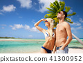 happy couple over exotic tropical beach background 41300952