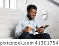 businessman with tablet pc and coffee on stairs 41301754
