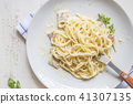 Spaghetti pasta with bolognese sauce and parmesan  41307135