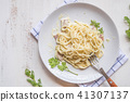 Spaghetti pasta with bolognese sauce and parmesan  41307137