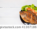 fried fish with vegetable on black dish. top view 41307186