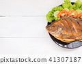 fried fish with vegetable on black dish. top view 41307187