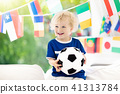 Kids watch football game. Child watching soccer. 41313784