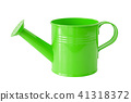 Green watering can, isolated on white. 41318372