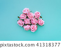 Satin pink rose buds on turquoise background. 41318377