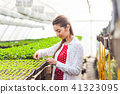Woman in greenhouse 41323095