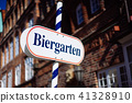 Beer garden sign. Opened shield in german biergarten on a sunny holiday. Old traditional german 41328910