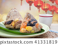 Rice dumplings or zongzi with tea (Chinese food) 41331819