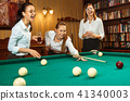Young women playing billiards at office after work. 41340003
