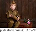 childr are soldier in retro military uniform  41346520
