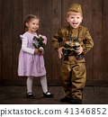 children as soldier in retro military uniform 41346852