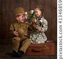 children as soldier in retro military uniform 41346859