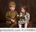 children as soldier in retro military uniform 41346863