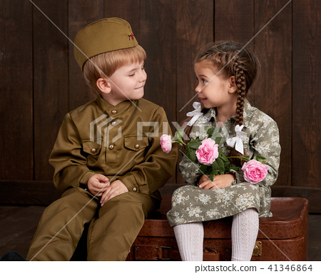 children as soldier in retro military uniform 41346864