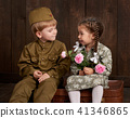children as soldier in retro military uniform 41346865
